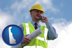 delaware map icon and an architect with blueprints, conversing on a cellular phone