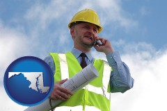 maryland map icon and an architect with blueprints, conversing on a cellular phone