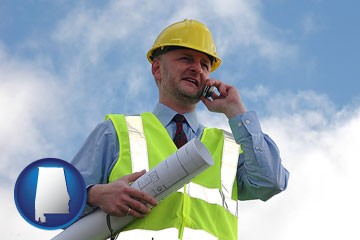 an architect with blueprints, conversing on a cellular phone - with Alabama icon