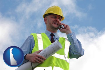 an architect with blueprints, conversing on a cellular phone - with Delaware icon