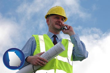 an architect with blueprints, conversing on a cellular phone - with Georgia icon