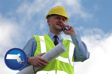 an architect with blueprints, conversing on a cellular phone - with Massachusetts icon