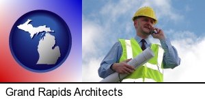 Grand Rapids, Michigan - an architect with blueprints, conversing on a cellular phone